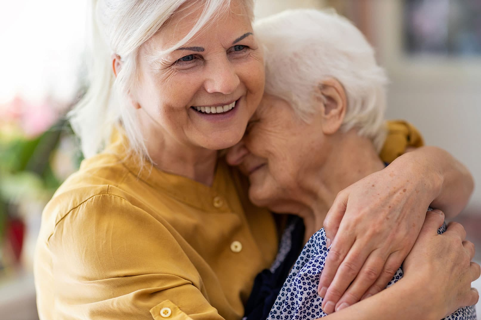 Senior woman hugging mom